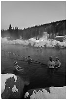 People soak in natural hot springs in winter. Chena Hot Springs, Alaska, USA (black and white)