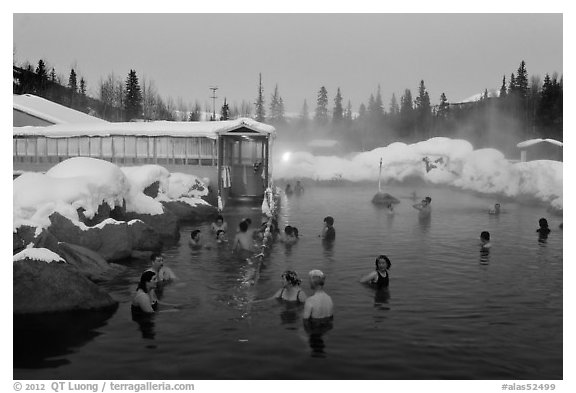 People soaking in outdoor hot springs pool in winter. Chena Hot Springs, Alaska, USA (black and white)