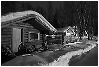 Cabins at night in winter. Chena Hot Springs, Alaska, USA (black and white)