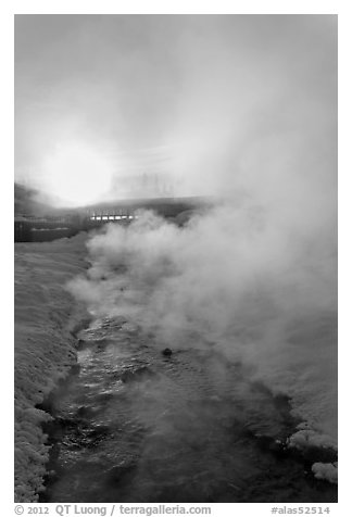 Oulet stream of hot springs and steam at sunrise. Chena Hot Springs, Alaska, USA (black and white)