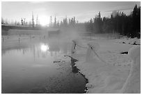 Pond of warm water at sunrise. Chena Hot Springs, Alaska, USA (black and white)