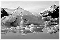 Portage Lake, with icebergs and mountain reflections. Alaska, USA (black and white)