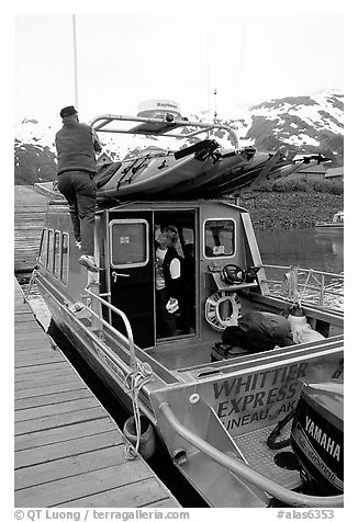 Kayaks loaded on a water taxi in Whittier. Whittier, Alaska, USA (black and white)