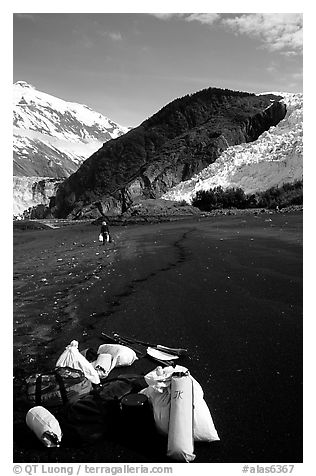 Kayaking gear on Black Sand Beach. Prince William Sound, Alaska, USA (black and white)