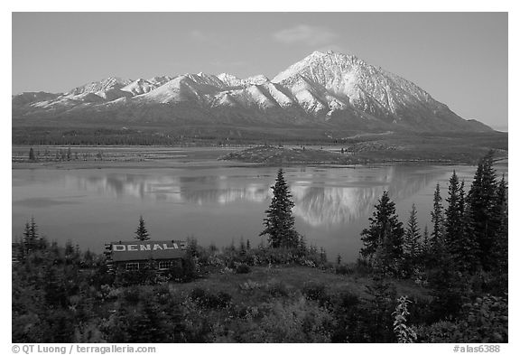 Mountains and lake at dusk, cabin with Denali sign. Alaska, USA (black and white)