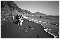 Backpackers on the beach,  Lost Coast. California, USA (black and white)