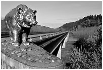 Golden bear adorning a bridge over the Klamath River. California, USA ( black and white)
