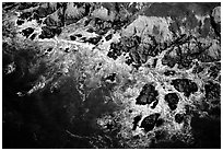 Aerial view of surf and rock. San Mateo County, California, USA ( black and white)