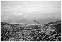 Aerial view of Santa Cruz with fog-covered ocean. Santa Cruz, California, USA (black and white)