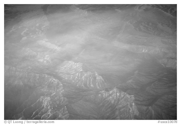 Aerial view of desert mountains with thin clouds. California, USA (black and white)