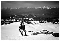Climber takes a break on the Green Ridge of Mt Shasta. California, USA ( black and white)