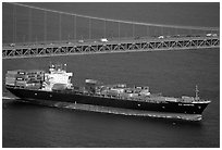 Container ship cruising under the Golden Gate Bridge. San Francisco, California, USA (black and white)