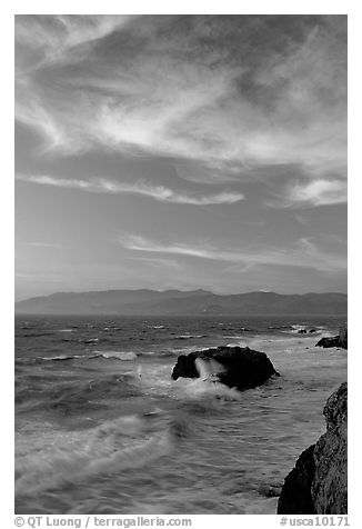 Surf and rocks at sunset seen from the Cliff House. San Francisco, California, USA (black and white)