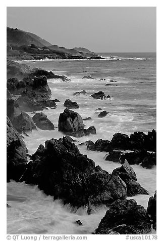 Coastline with pointed rocks and surf, sunset, Garapata State Park. Big Sur, California, USA (black and white)