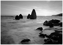 Wave action, seastacks and rocks with sun setting, Rodeo Beach. California, USA (black and white)