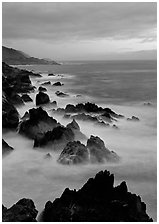 Rocks and surf near Rocky Cny Bridge, Garapata State Park, dusk. Big Sur, California, USA (black and white)