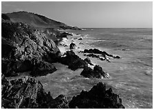 Surf and rocks at sunset, near Rocky Cny Bridge, Garapata State Park. Big Sur, California, USA (black and white)