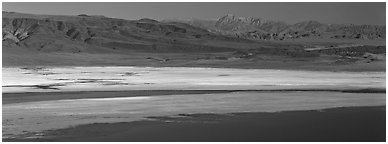 Desert landscape with Owens Lake and mountains. California, USA (Panoramic black and white)