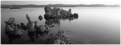 Lake sunrise with Tufa pinnacles. Mono Lake, California, USA (Panoramic black and white)