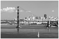 Sailboat, Golden Gate Bridge with city skyline, afternoon. San Francisco, California, USA (black and white)