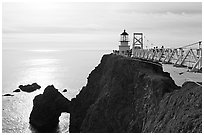 Narrow bridge leading to the Point Bonita Lighthouse, afternoon. California, USA (black and white)