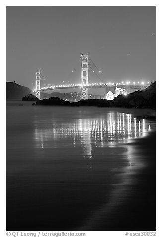 Golden Gate bridge at night from Baker Beach. San Francisco, California, USA (black and white)
