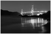 Golden Gate bridge at night from Baker Beach. San Francisco, California, USA ( black and white)