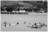Sea kayaking in  Pillar point harbor. Half Moon Bay, California, USA (black and white)