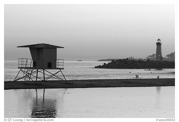 Beach cabin and lighthouse, Twin Lakes State Beach, sunset. Santa Cruz, California, USA (black and white)