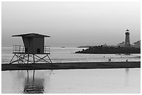 Beach cabin and lighthouse, Twin Lakes State Beach, sunset. Santa Cruz, California, USA ( black and white)