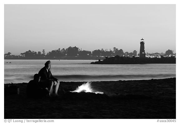Camp Fire on the beach at sunset. Santa Cruz, California, USA (black and white)