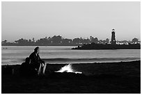 Camp Fire on the beach at sunset. Santa Cruz, California, USA ( black and white)