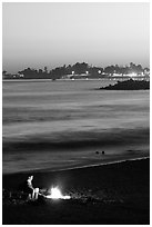 Bonfire on the beach at sunset. Santa Cruz, California, USA ( black and white)