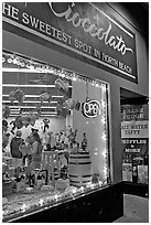 Chocolate store on Columbus Avenue at night, North Beach. San Francisco, California, USA ( black and white)