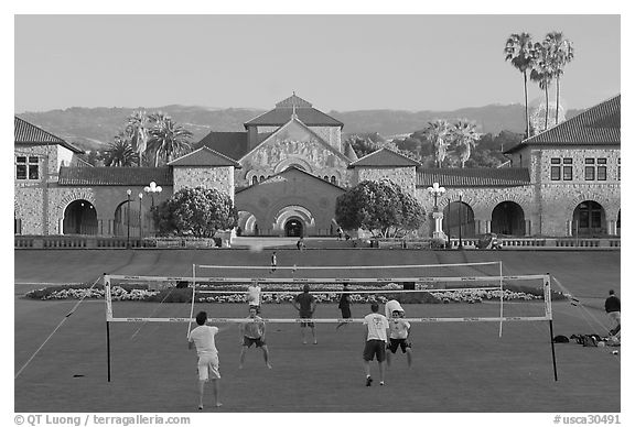 Volley-ball players in front of the Quad, late afternoon. Stanford University, California, USA (black and white)