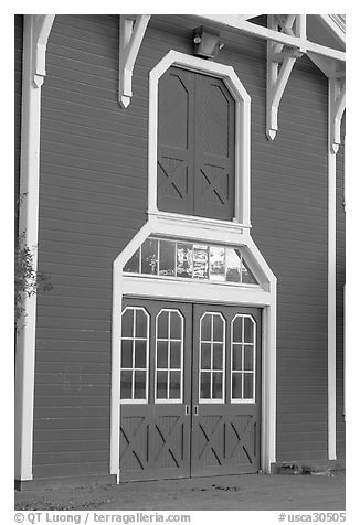 Door with sunset reflections, Red Barn. Stanford University, California, USA (black and white)