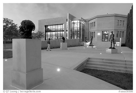 Rodin sculpture garden and Cantor Center for Visual Arts with one visitor. Stanford University, California, USA (black and white)