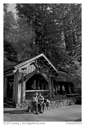 Couple sitting in front of park headquarters, afternoon. Big Basin Redwoods State Park,  California, USA (black and white)