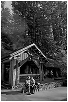Couple sitting in front of park headquarters, afternoon. Big Basin Redwoods State Park,  California, USA ( black and white)