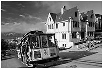 Cable car climbing, and Tudor house, late afternoon. San Francisco, California, USA (black and white)