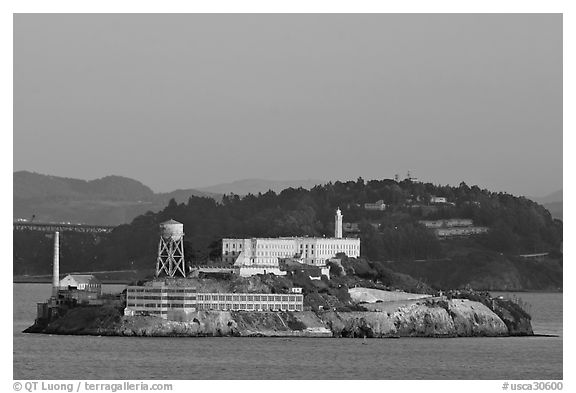 Alcatraz Island at sunset, with Yerba Buena Island in the background. San Francisco, California, USA (black and white)
