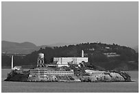 Alcatraz Island at sunset, with Yerba Buena Island in the background. San Francisco, California, USA ( black and white)