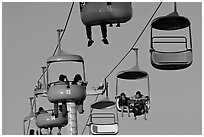 Sky glider chairs, Beach Boardwalk. Santa Cruz, California, USA ( black and white)