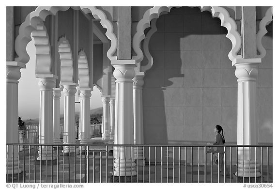 Indian girl running amongst columns of the Sikh Temple. San Jose, California, USA