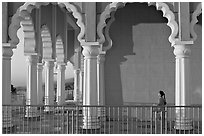 Indian girl running amongst columns of the Sikh Temple. San Jose, California, USA (black and white)