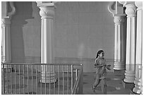 Indian girl running in the Sikh Gurdwara Temple, late afternoon. San Jose, California, USA ( black and white)