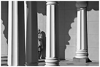 Woman and colonade, Sikh Gurdwara Temple. San Jose, California, USA (black and white)