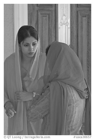 Indian woman in sari, Sikh Gurdwara Temple. San Jose, California, USA (black and white)