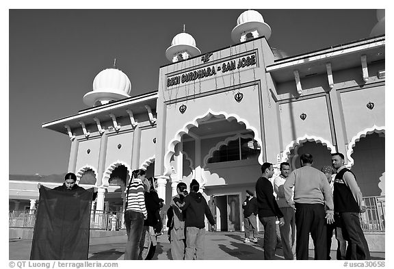 Indian immigrants gathering in fron of the Sikh Gurdwara Temple. San Jose, California, USA (black and white)