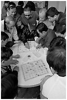 Vietnamese immigrants playing Chinese chess in a patio. San Jose, California, USA ( black and white)